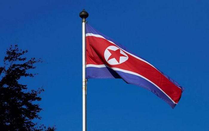 FILE PHOTO – A North Korean flag flies on a mast at the Permanent Mission of North Korea in Geneva